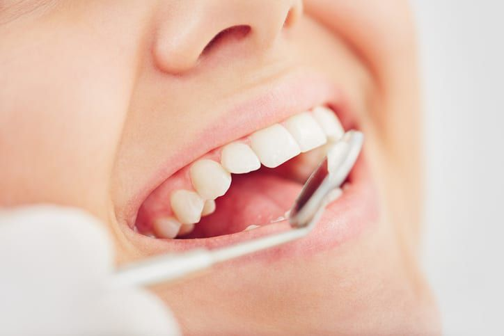 Patient receiving periodontal maintenance at River Run Family Dentistry