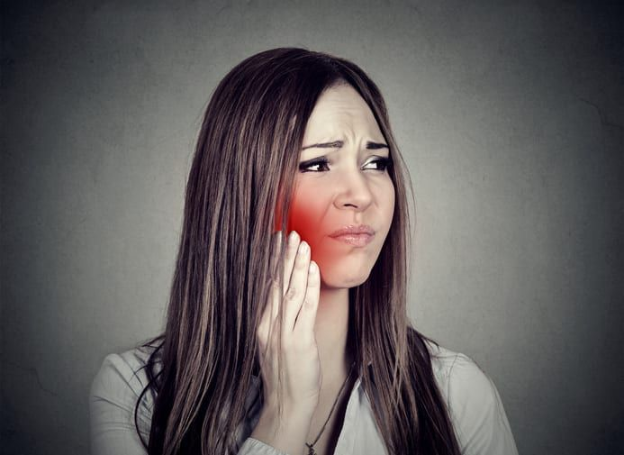 Patient suffering from TMD at River Run Family Dentistry